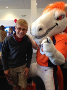Alek with our beloved Broncos mascot, Miles